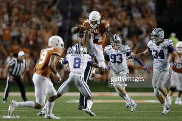 Lorenzo Joe of the Texas Longhorns hurdles Duke Shelley of the Kansas State Wildcats in the fourth quarter at Darrell K RoyalTexas Memorial Stadium...