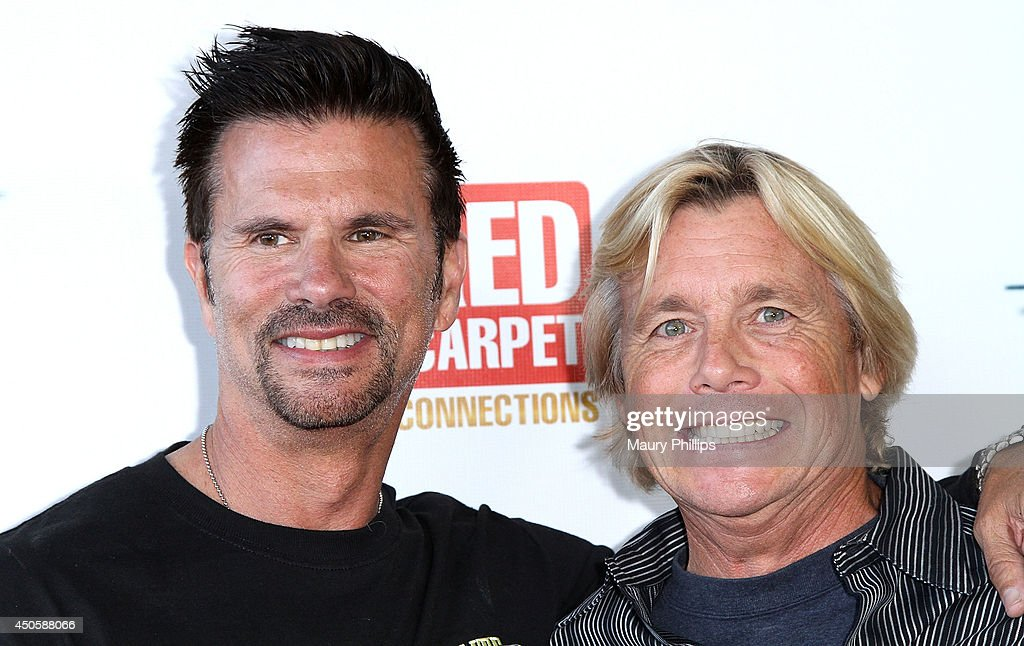 Lorenzo Lamas and Christopher Atkins arrive at Lorenzo Lamas' New Business Elite Helicopter launch party at the Van Nuys Airport on June 13, 2014 in Van Nuys, California.
