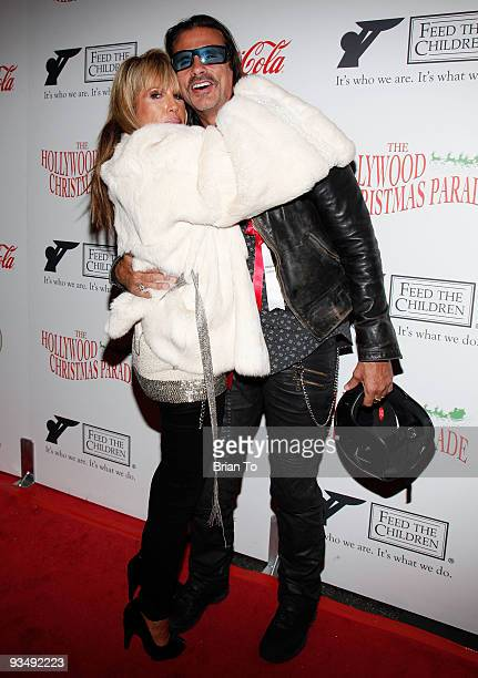 Lorenzo Lamas and ex wife Michelle Smith attend the 2009 Hollywood Christmas Parade on November 29 2009 in Hollywood California