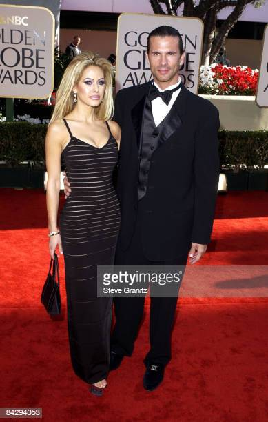 Lorenzo Lamas wife Shauna Sand arrive at the Golden Globe Awards at the Beverly Hilton January 20 2002 in Beverly Hills California