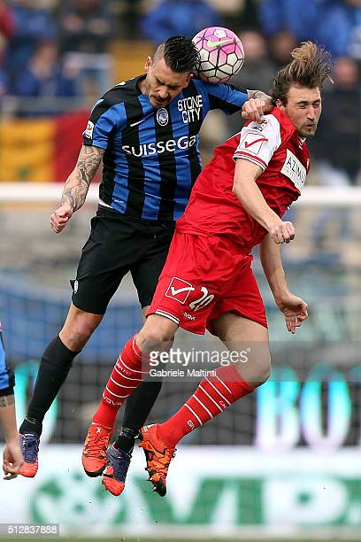 Lorenzo Lollo of Carpi FC battles for the ball with Mauricio Pinilla of Atalanta BC during the Serie A match between Carpi FC and Atalanta BC at...