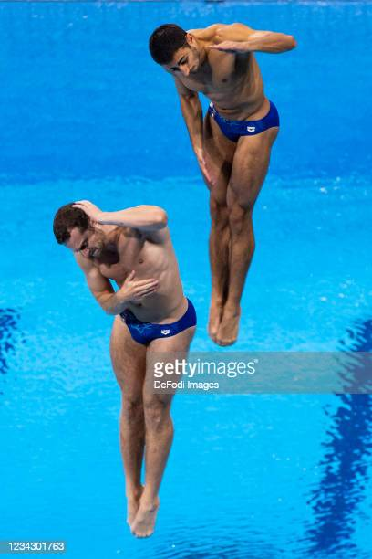 Lorenzo Marsaglia of Italy and Giovanni Tocci of Italy compete during the Men's Synchronised 3m Springboard Final on day five of the Tokyo 2020...