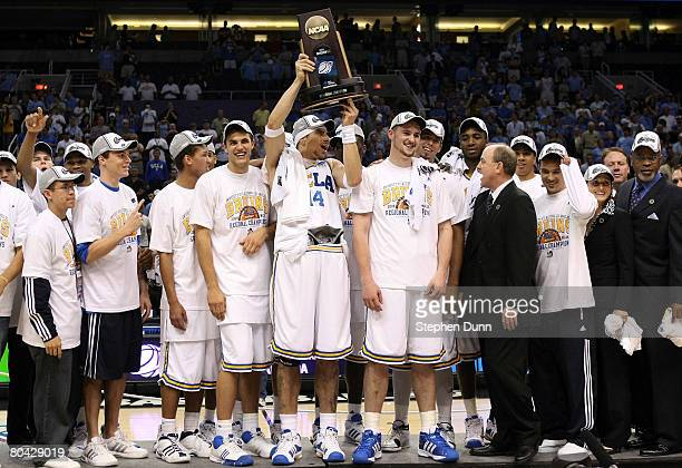 Lorenzo Mata-Rael of the UCLA Bruins hoists the West Regional trophy with his team after they defeated the Xavier Musketeers with the score of 76-57...