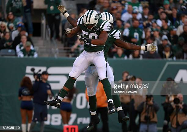 Lorenzo Mauldin of the New York Jets celebrates sacking quarterback Case Keenum of the Los Angeles Rams with teammate Darron Lee in the second...