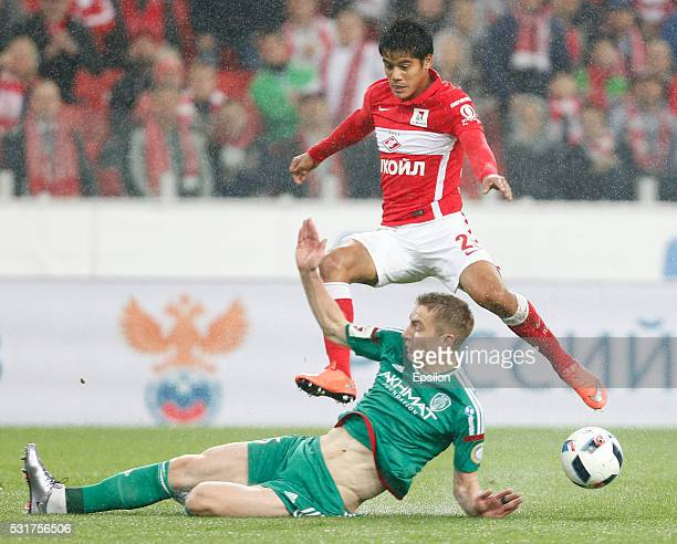 Lorenzo Melgarejo of FC Spartak Moscow is challenged by Andrei Semyonov of FC Terek Grozny during the Russian Premier League match between FC Spartak...