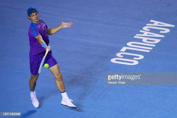 Lorenzo Musetti of Italy hits a forehand during the Men's singles match between Diego Schwartzman of Argentina and Lorenzo Musetti of Italy as part...