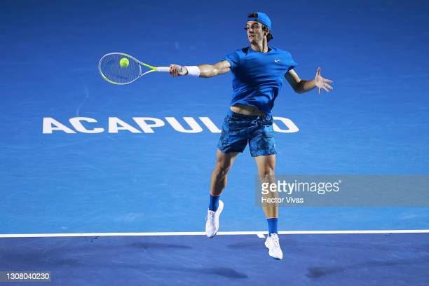 Lorenzo Musetti of Italy plays a forehand during the semifinal match between Stefanos Tsitsipas of Greece and Lorenzo Musetti of Italy as part of the...