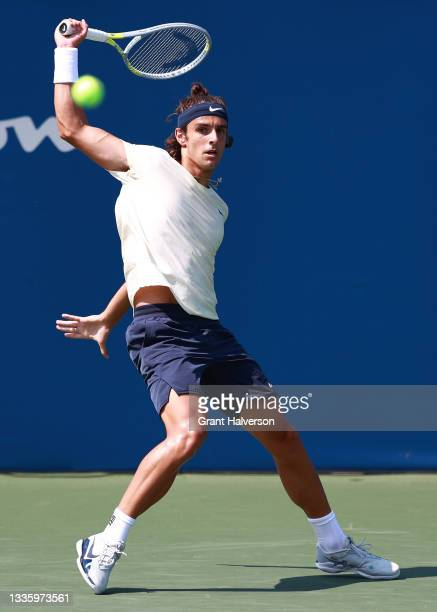 Lorenzo Musetti of Italy returns a shot to Federico Coria of Argentina during the Winston-Salem Open at Wake Forest Tennis Complex on August 23, 2021...