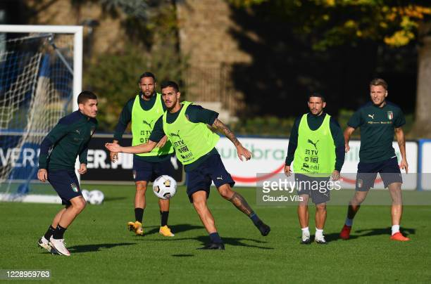 Lorenzo Pellegrini and Marco Verratti of Italy in action during a training session at Centro Tecnico Federale di Coverciano on October 8, 2020 in...