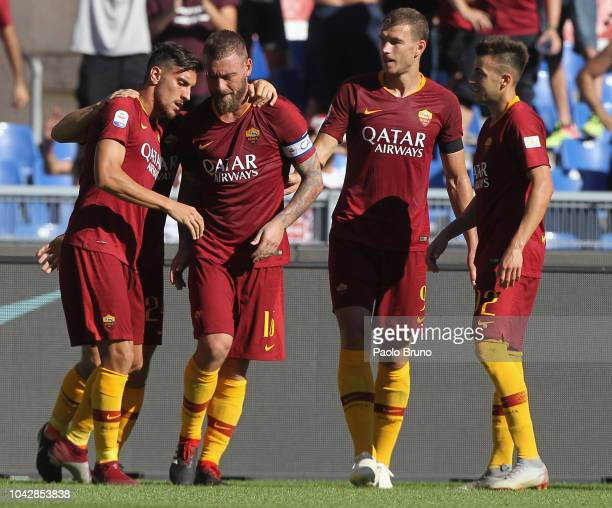 Lorenzo Pellegrini celebrates with his teammates of AS Roma after scoring the opening goal during the Serie A match between AS Roma and SS Lazio at...