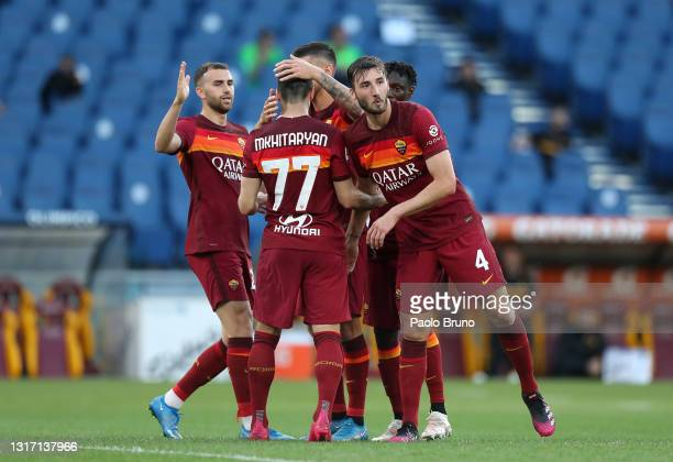 Lorenzo Pellegrini of A.S Roma celebrates with Henrikh Mkhitaryan and Bryan Cristante after scoring their side's third goal during the Serie A match...