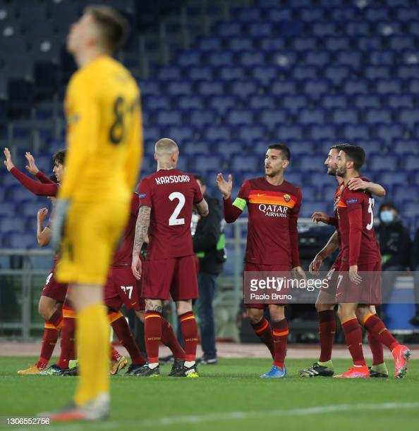 Lorenzo Pellegrini of A.S Roma celebrates with team mate Rick Karsdorp and team mates after scoring their side's first goal during the UEFA Europa...