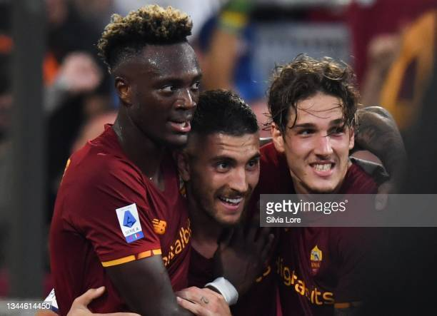 Lorenzo Pellegrini of AS Roma celebrates with teammate Nicolò Zaniolo and Tammy Abraham after scoring goal 1-0 during the Serie A match between AS...