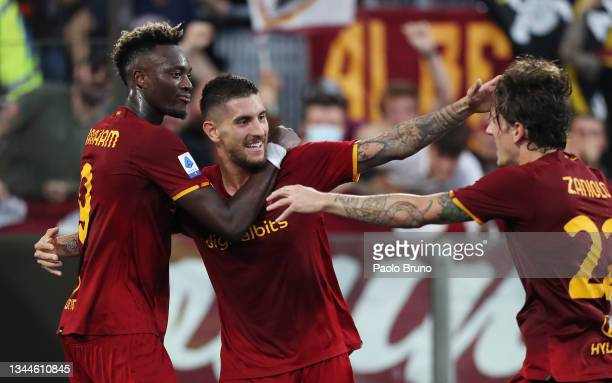 Lorenzo Pellegrini of AS Roma celebrates with teammates Tammy Abraham and Nicolo Zaniolo after scoring their side's first goal during the Serie A...