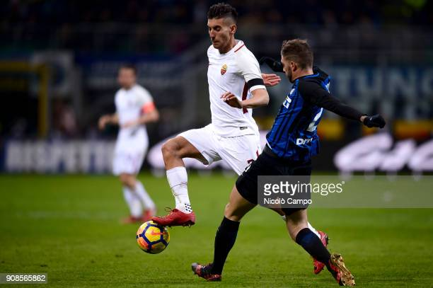 Lorenzo Pellegrini of AS Roma competes for the ball with Davide Santon of FC Internazionale during the Serie A football match between FC...