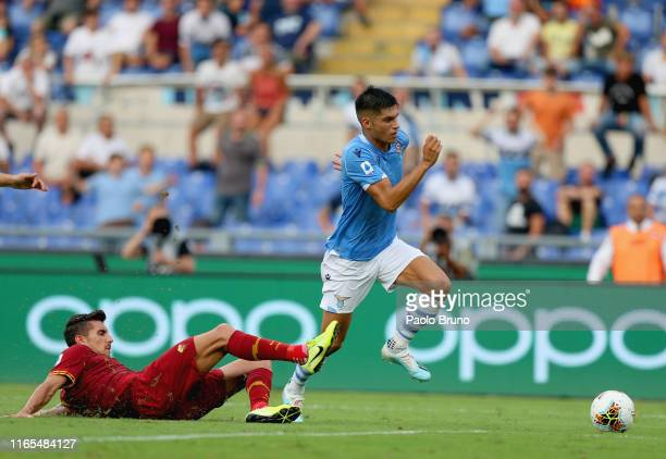 Lorenzo Pellegrini of AS Roma competes for the ball with Joaquin Correa of SS Lazio during the Serie A match between SS Lazio and AS Roma at Stadio...