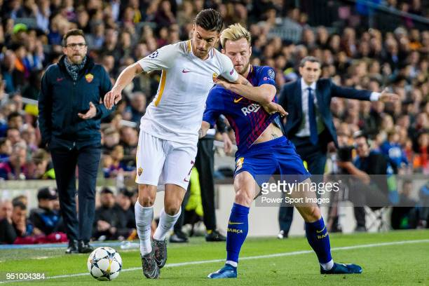 Lorenzo Pellegrini of AS Roma fights for the ball with Ivan Rakitic of FC Barcelona during the UEFA Champions League 201718 quarterfinals match...