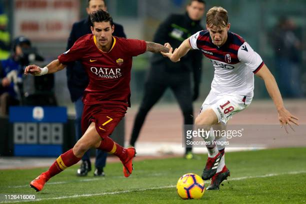 Lorenzo Pellegrini of AS Roma Filip Helander of Bologna FC during the Italian Serie A match between AS Roma v Bologna at the Stadio Olimpico Rome on...
