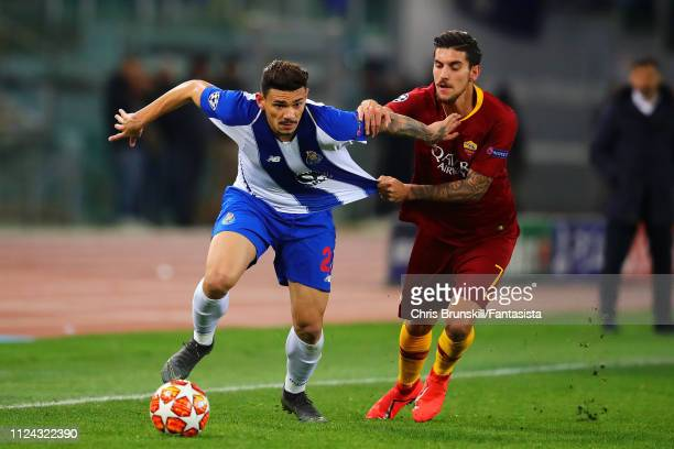 Lorenzo Pellegrini of AS Roma in action with Francisco Soares of FC Porto during the UEFA Champions League Round of 16 First Leg match between AS...