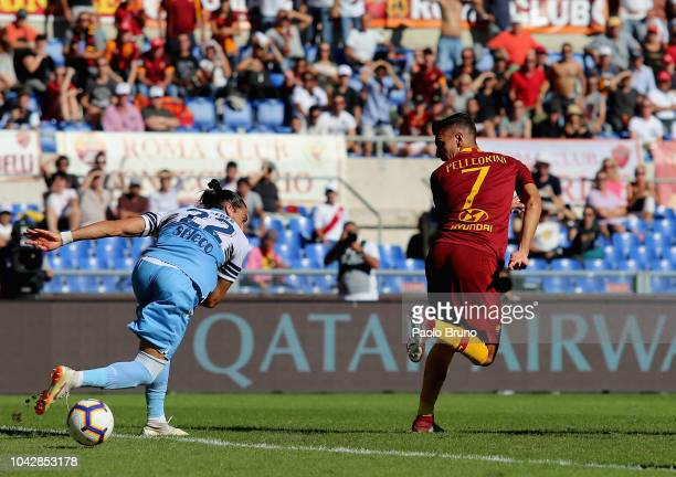 Lorenzo Pellegrini of AS Roma scores the opening goal during the Serie A match between AS Roma and SS Lazio at Stadio Olimpico on September 29 2018...