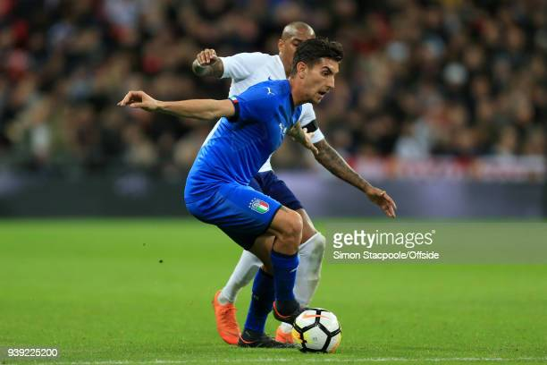 Lorenzo Pellegrini of Italy battles with Ashley Young of England during the international friendly match between England and Italy at Wembley Stadium...