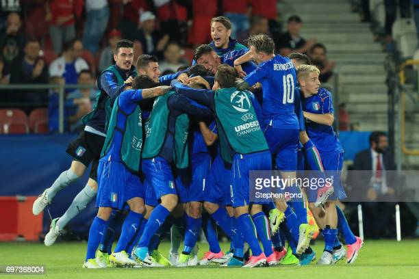 Lorenzo Pellegrini of Italy celebrates scoring his sides first goal with his Italy team mates during the UEFA European Under-21 Championship Group C...