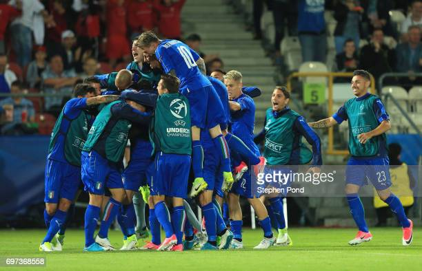 Lorenzo Pellegrini of Italy celebrates scoring his sides first goal with his Italy team mates during the UEFA European Under21 Championship Group C...