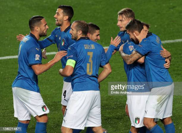 Lorenzo Pellegrini of Italy celebrates with his team-mates after scoring the opening goal during the UEFA Nations League group stage match between...