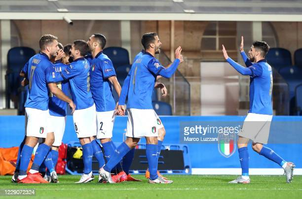 Lorenzo Pellegrini of Italy celebrates with team-mates after scoring the opening goal during the UEFA Nations League group stage match between Italy...
