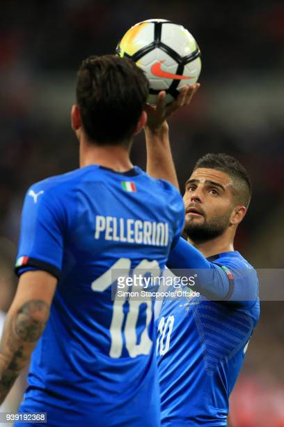 Lorenzo Pellegrini of Italy holds the ball beyond teammate Lorenzo Insigne of Italy during the international friendly match between England and Italy...