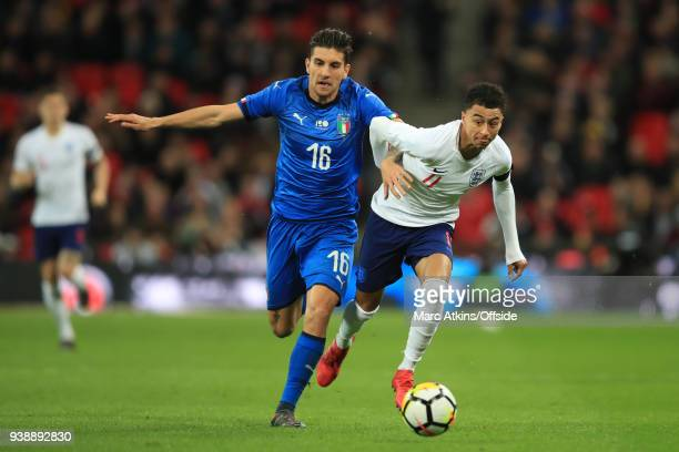 Lorenzo Pellegrini of Italy in action with Jesse Lingard of England during the International Friendly match between England and Italy at Wembley...