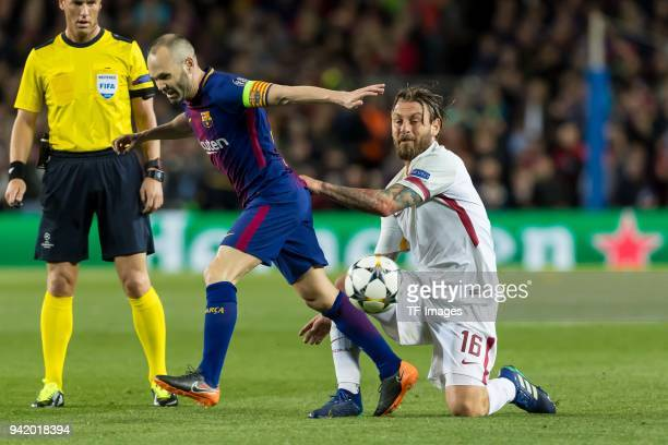 Lorenzo Pellegrini of Rom and Ivan Rakitic of Barcelona battle for the ball during the UEFA Champions League QuarterFinal first leg match between FC...