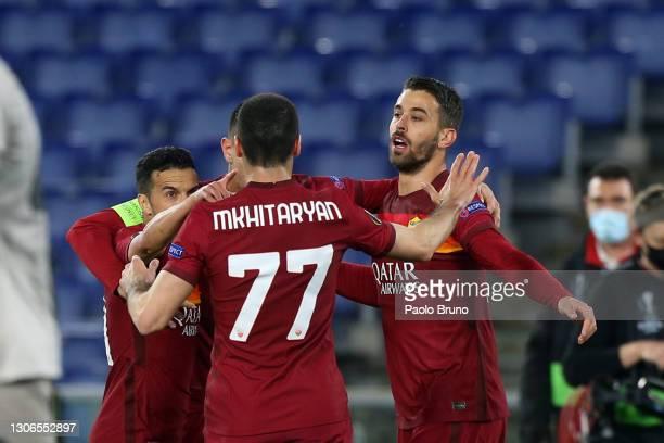 Lorenzo Pellegrini of Roma celebrates with Henrikh Mkhitaryan and teammates after scoring their team's first goal during the UEFA Europa League Round...