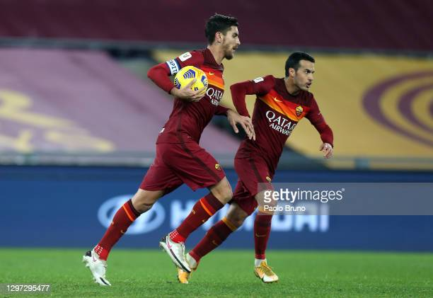 Lorenzo Pellegrini of Roma celebrates with team mate Pedro after scoring their sides first goal from the penalty spot during the Coppa Italia match...