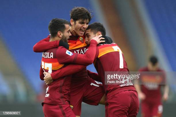 Lorenzo Pellegrini of Roma celebrates with team mates Leonardo Spinazzola and Gonzalo Villar after scoring their sides first goal during the Serie A...