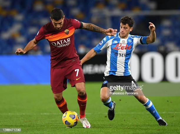 Lorenzo Pellegrini of Roma is challenged by Diego Demme of SSC Napoli during the Serie A match between SSC Napoli and AS Roma at Stadio San Paolo on...