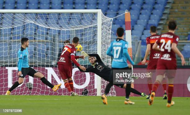 Lorenzo Pellegrini of Roma scores their team's fourth goal past Ivan Provedel of Spezia during the Serie A match between AS Roma and Spezia Calcio at...