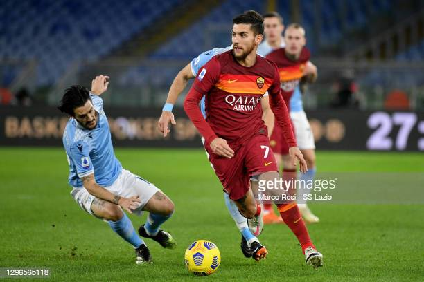Lorenzo Pellegrini of SS Lazio compete for the ball with Luis Alberto of AS Roma during the Serie A match between SS Lazio and AS Roma at Stadio...