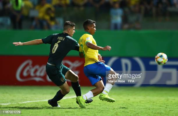 Lorenzo Pirola of Italy looks to break past Veron of Brazil during the FIFA U-17 World Cup Quarter Final match between Italy and Brazil at the...