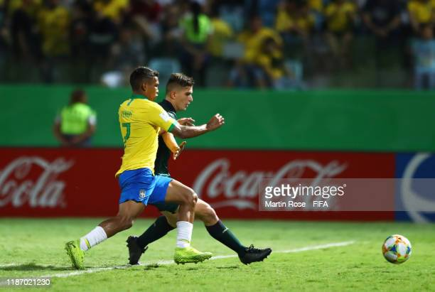 Lorenzo Pirola of Italy looks to break past Veron of Brazil during the FIFA U17 World Cup Quarter Final match between Italy and Brazil at the Estádio...