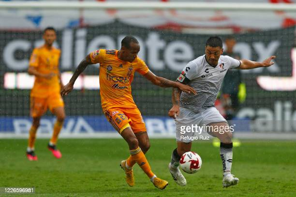 Lorenzo Reyes Atlas fights for the ball with Luis Quiñones of Tigres during the match between Atlas and Tigres UANL as part of the friendship...