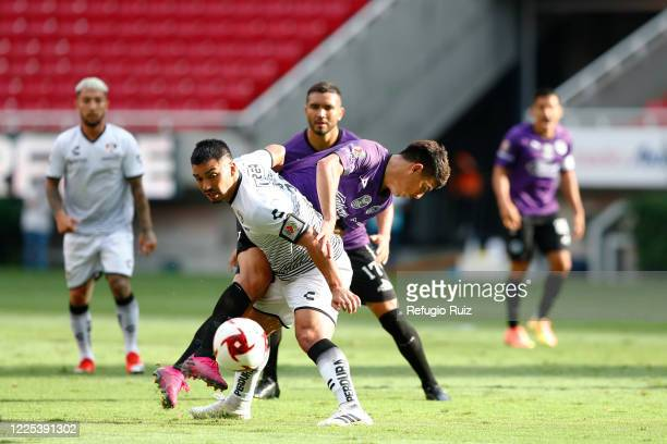 Lorenzo Reyes of Atlas fights for the ball with Angel Mendoza of Mazatlan during the match between Atlas and Mazatlan FC as part of the friendly...