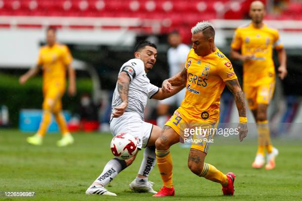 Lorenzo Reyes of Atlas fights for the ball with Jesús Dueñas of Tigres during the match between Atlas and Tigres UANL as part of the friendship...
