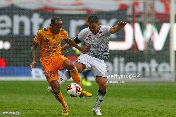 Lorenzo Reyes of Atlas fights for the ball with Luis Quiñones of Tigres during the match between Atlas and Tigres UANL as part of the friendship...
