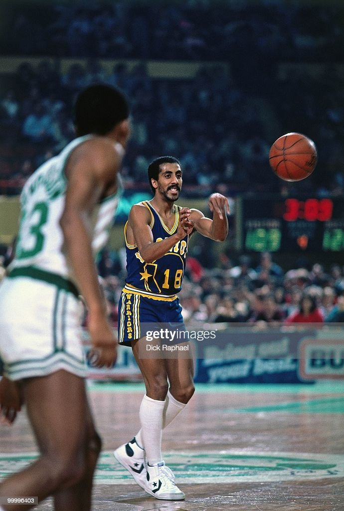Lorenzo Romar #18 of the Golden State Warriors passes against the Boston Celtics during a game played in 1983 at the Boston Garden in Boston, Massachusetts.