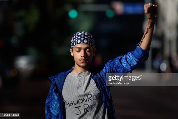 Lorenzo Rulli of McKees Rocks Pennsylvania pauses in the street as demonstrators stop traffic a day after the funeral of Antwon Rose II on June 26...