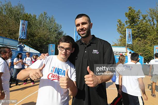 Lorenzo Sanz of Real Madrid poses with participants during the Special Olympics Unified Clinic as part of the 2016 Global Games on October 1 2016 at...