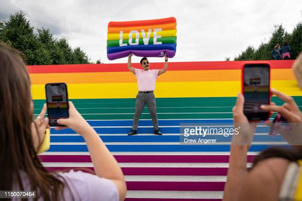 Lorenzo Soler poses for photos on the steps that are covered in rainbow colors for Pride Month at Franklin D Roosevelt Four Freedoms Park June 14...