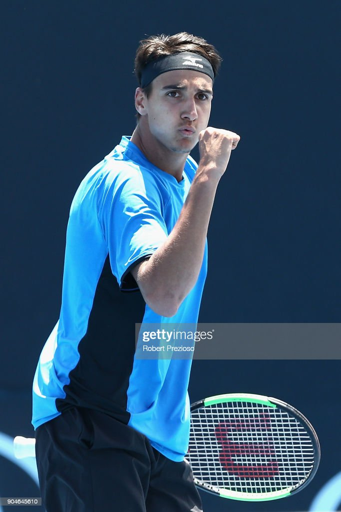 Lorenzo Sonego of Italy celebrates a point as he competes in his third round match against Bernard Tomic of Australia during 2018 Australian Open Qualifying at Melbourne Park on January 14, 2018 in Melbourne, Australia.
