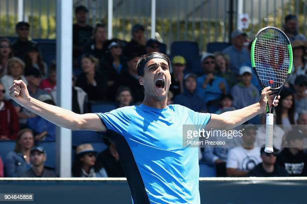 Lorenzo Sonego of Italy celebrates winning his third round match against Bernard Tomic of Australia during 2018 Australian Open Qualifying at...